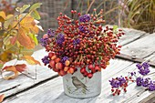 Small berry bouquet of rose (rosehip) and callicarpa