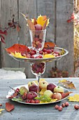 Home-made cake stand made of wine glasses and silver bowls