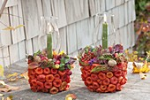 Pots stuck with lanterns as decorative containers