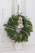 Easter wreath from Buxus (Box) with Easter wafer
