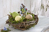 Easter nest with moss, Easter wafer 'easter bunny' and easter eggs