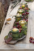 Autumn table decoration with mason jars as lantern flowers