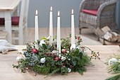 Advent wreath out of mixed branches green-white-red