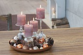 Unusual Advent decoration with candles on inverted glasses