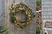 Wreath of clematis, Picea cones, Ilex