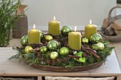 Advent wreath made of mixed coniferous green, decorated