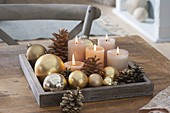 Simple Advent decoration with golden Christmas tree balls