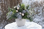 Frozen Christmas bouquet in the snow