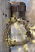 Wreath of winded grass, decorated with fragrant flowers