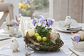 Easter nest of branches and moss as a table decoration