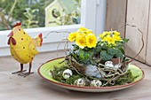 Easter bowl with moss and wreath from Salix (corkscrew willow)