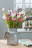 Bouquet of tulipa (tulip) and malus (apple) branches
