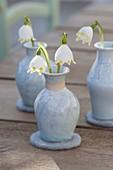 Leucojum (spring snowflake) flowers in ceramic vases