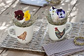 Easter table decoration in cups with chicken decor
