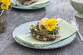 Easter table decoration with horned violets