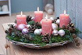 Advent wreath in basket bowl with Christmas baubles, Abies branches