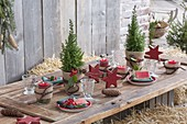 Christmas table decoration with straw bales on the terrace