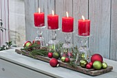 Quick Advent decoration with inverted wine glasses as a candle holder