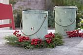Tin lanterns with Pinus and red Ilex berries