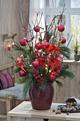 Green-red bouquet made of Cornus (dogwood) and Pinus branches