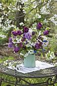 Purple and white spring bouquet under cherry tree tulipa 'Purple Prince'