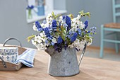 Small bouquet with branches of prunus (cherry), muscari