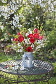 Red-white bouquet made of branches of Prunus, Malus