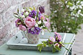 Small bouquet in cup on tray, Fritillaria meleagris