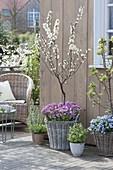 Spring arrangement on wooden deck