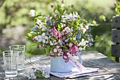 Small bouquet in enamel pot, Malus (ornamental apple), Brunnera