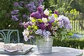Bouquet of syringa (lilac), viburnum lantana (snowball)