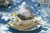White Easter table decoration on the terrace
