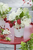 Small bouquet of strawberries and elderflowers
