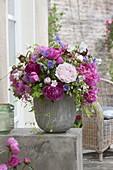 Lush bouquet of Paeonia (peony), geranium