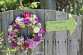 Fragrant wreath of roses, woodruff flowers and unripe apples