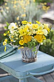 Yellow summer bouquet in basket vase, Achillea, Hemerocallis