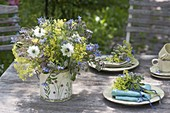 Small table decoration with borage, alchemilla