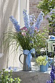 Jug with delphinium, achillea and grasses
