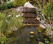 Pond with small artificial stream maed with stone bowls