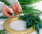 Wreath bind with mixed conifer branches