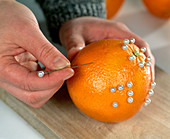 Decorate oranges with pearl pins