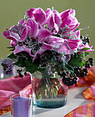 Bouquet with cyclamen, berry jewelery and curry herb
