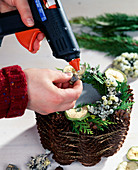 Candle decoration with pine cones - stick the decoration fruits with hot glue gun