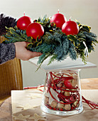 Advent wreath on decorated glass, wreath on wooden board