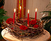 Advent wreath of dry branches with rose petals