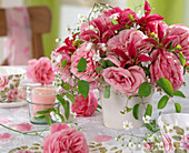Pink roses, Clematis flowers, Gypsophila (Gypsophila)