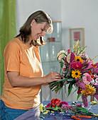 Tying summer bouquet