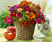 Bouquet of dahlias, battlements, Callistephus (Sommeraster), grasses
