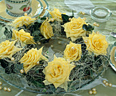 Wreath made of hedera (ivy) and yellow roses