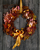 Door wreath of various autumn leaves, oaks and maple leaves